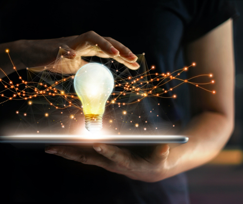 image of lightbulb and a persons hand
